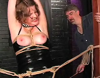 Black sunshine  black rubber rose  gets tightly bound at the wrists and bent over for a lashing. Black rubber Rose  gets tightly bound at the wrists and bent over for a lashing